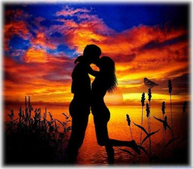 kissy couple sunset